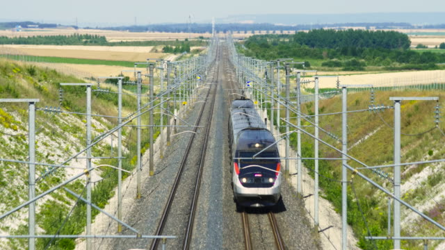 french high speed tgv train approaches, marne department, champagne - tgv点の映像素材/bロール