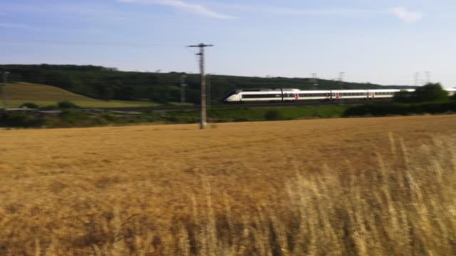 vidéos et rushes de french high speed tgv train drives past wheat field, meuse department, lorraine - train
