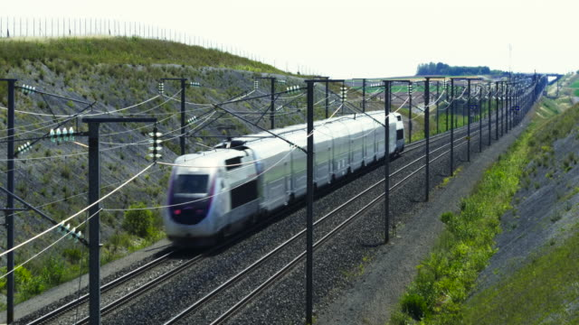 french high speed tgv train on gravel tracks, marne department, champagne - tramway stock videos & royalty-free footage