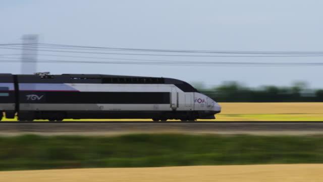 french high speed tgv train passes wheat field, marne department, champagne - tgv点の映像素材/bロール