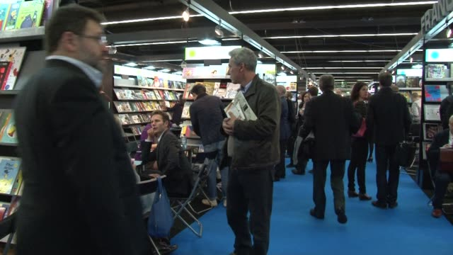 french literature professionals at the frankfurt book fair happy that fellow novelist patrick modiano wins the 2014 nobel prize - literature stock videos & royalty-free footage