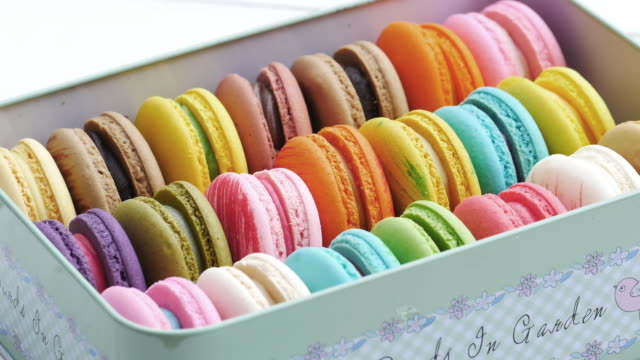 french macaroon dessert in the box. row fo colorful french macarons. - macaroon stock videos and b-roll footage