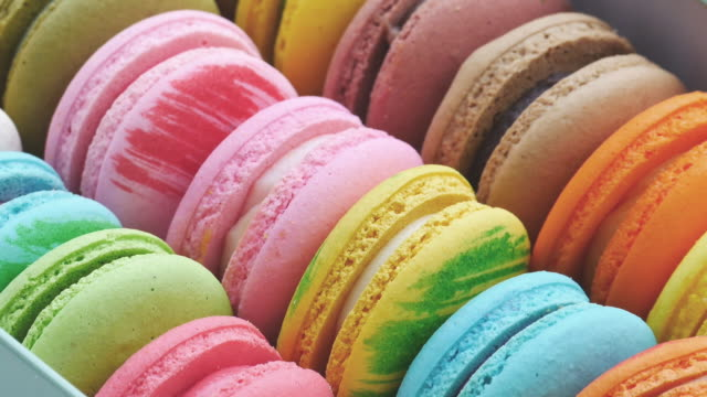 french macaroon dessert in the box. row fo colorful french macarons. - sugar stock videos & royalty-free footage