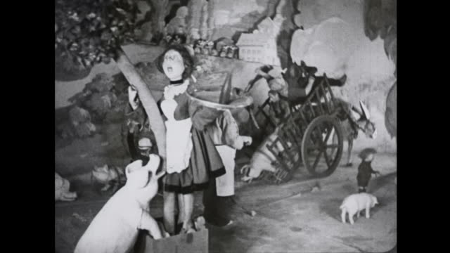 1939 french maid toy clings to tree in simulated toy town hurricane - puppet stock videos & royalty-free footage