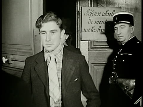 stockvideo's en b-roll-footage met french men entering building w/ officer vs men undressing ms naked recruits line up to get physical ms doctor w/ stethoscope recruit inhaling cu hand... - 1938