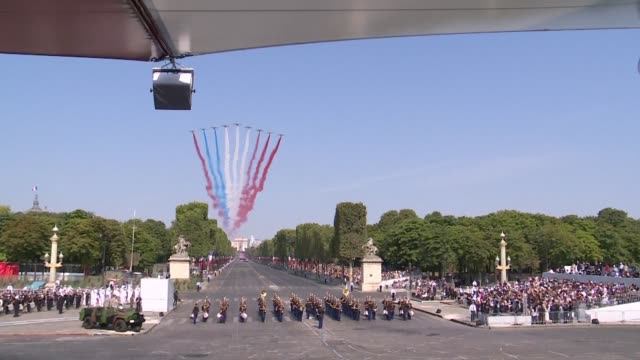 french military and civil planes fly over the champs elysees during annual bastille day military parade on july 14 - avenue des champs elysees stock videos & royalty-free footage