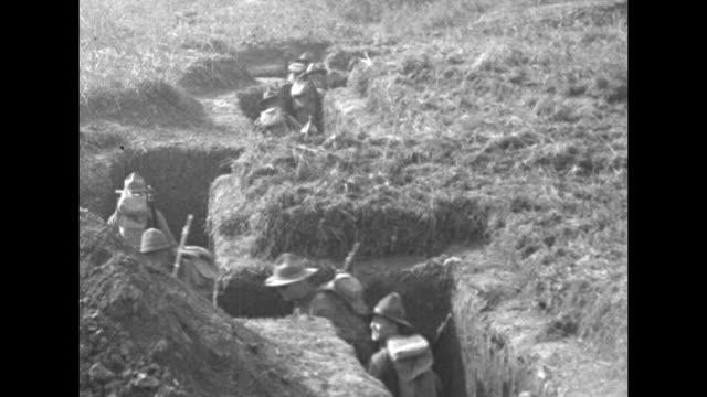 french military officers approach look over us soldiers dug into foxholes / us soldiers walk through twisting trench / soldiers in another trench... - trench stock videos & royalty-free footage