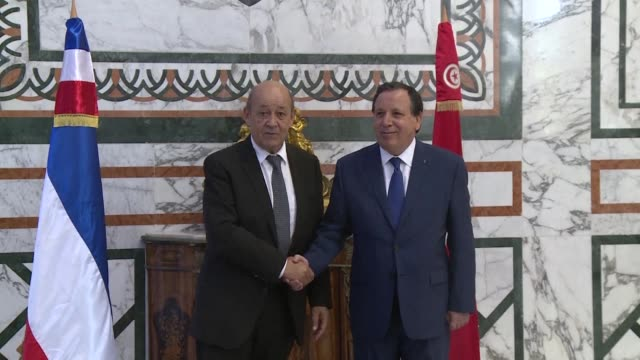 French Minister of Foreign Affairs JeanYves Le Drian meets with his Tunisian counterpart Khemaies Jhinaoui in Tunis before they give a press...