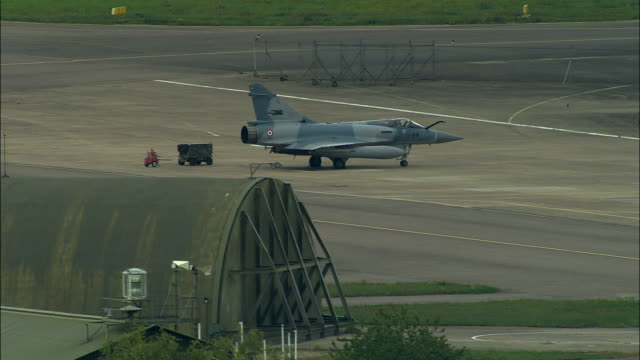 aerial ws french mirage jet on military airport runway / dijon, france - stationary stock videos & royalty-free footage