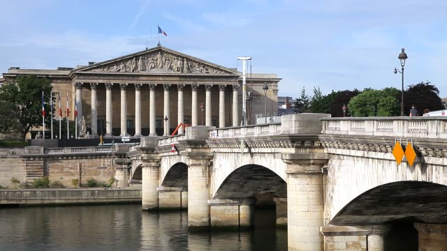 French National Assembly building front view with Seine river in foreground