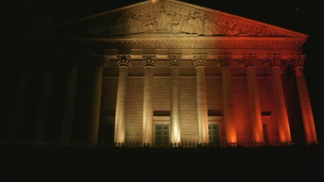 French national assembly in Paris with Belgian colors tribute to victims of Bruxelles bombing