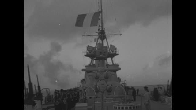 french naval cruiser bridge, radar, guns / side guns fire, sailors on deck, french flag flies on ship / gun barrels, clouds and seagulls / sailor... - radar stock videos & royalty-free footage