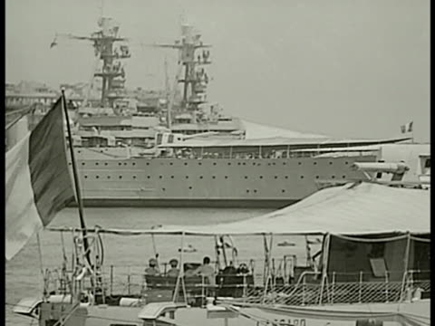 french navy battle ships in port ws french battle ship in harbor france flag fg ws men on dock battle ship bg la ws battle ship docked vs france... - anno 1938 video stock e b–roll