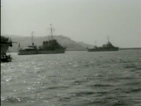 french navy ships anchored in bizerte harbor. navy convoy ships at sea. port side of ship at sea, convoy bg. france flag. battleships at sea.... - french army stock videos & royalty-free footage