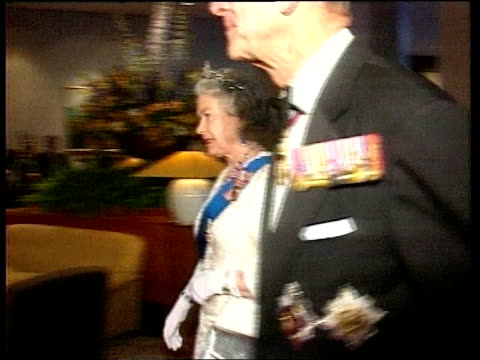 CHOGM French nuclear testing INT Queen Elizabeth II in evening dress and sash and tiara RL with Prince Philip wearing medals both to BV MS SIDE Major...