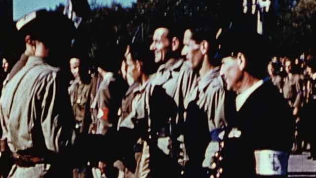 french officer awarding decorations to french resistance fighters with flags waving / france - esercito militare francese video stock e b–roll