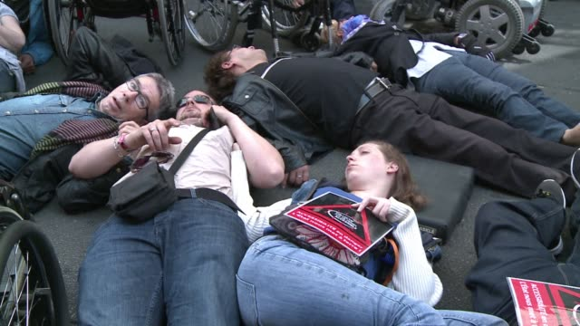 french paraplegics fake their death in central paris to raise awareness of the countrys lag in policies promoting wheelchair accessibility - disability awareness stock videos & royalty-free footage