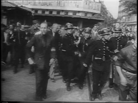 french police carrying snipers through streets angry mobs on either side throwing things at them / closeup on snipers with hands on their heads... - anno 1944 video stock e b–roll
