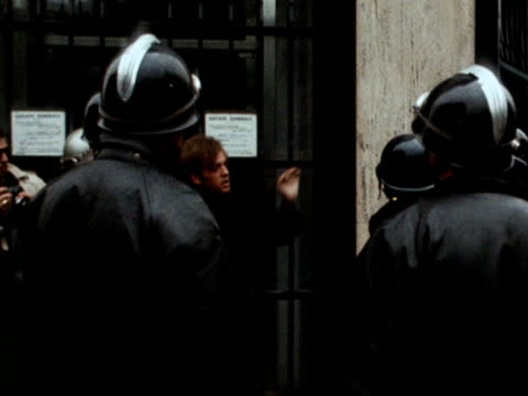 french police hit a student on a street in paris during the student protests 1968 - 1968 stock-videos und b-roll-filmmaterial