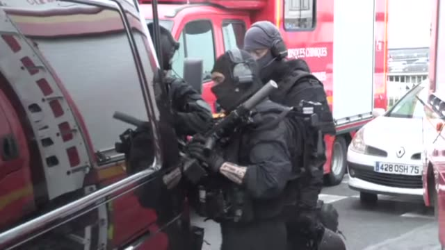 French police officers from the RAID unit converge on Paris' Orly airport after a man tried to grab a female soldier's weapon triggering a major...
