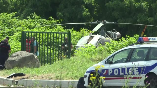french police stand next to a helicopter after a notorious career thief who was once france's mostwanted man pulled off a daring jailbreak on sunday... - prison escape stock videos and b-roll footage