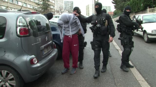 stockvideo's en b-roll-footage met french police swooped on suspected radical islamists in pre-dawn raids for the second time in less than a week wednesday, arresting 10 people, a... - dawn french