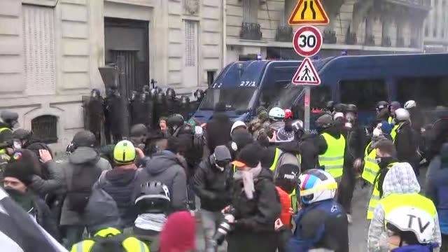 french police used pepper spray against yellow vest protesters along the champselysees in the capital paris on saturday the yellow vests protesting... - time's up social movement stock videos and b-roll footage