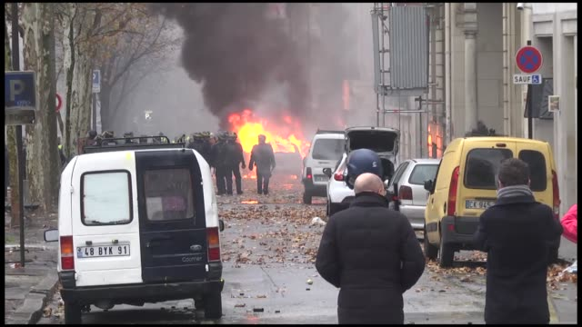 vídeos de stock, filmes e b-roll de french police used tear gas and water cannons on saturday to disperse protests against a hike in fuel prices that turned violent in paris thousands... - vest
