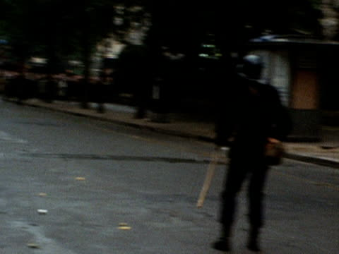 french policemen throw concussion grenades at student rioters in paris 1968 - 1968 stock videos & royalty-free footage