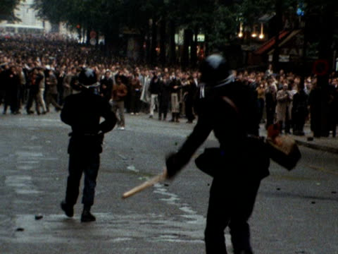 french policemen throw concussion grenades at student rioters in paris 1968 - 1968 stock-videos und b-roll-filmmaterial