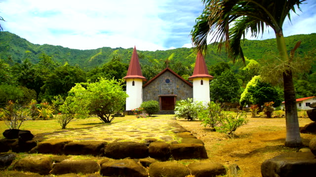 french polynesian church and cemetery hatiheu nuku hiva - französisch polynesien stock-videos und b-roll-filmmaterial