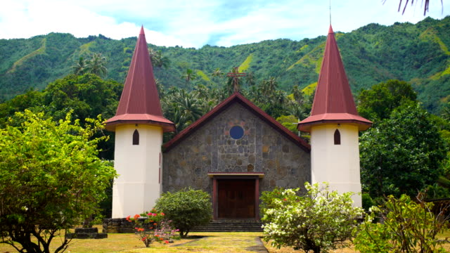 french polynesian church and cemetery hatiheu nuku hiva - tahitian culture stock videos and b-roll footage