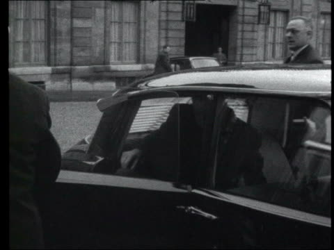 bw french president charles de gaulle out of car into building lib bw child at desk changing old francs for new - charles de gaulle stock videos and b-roll footage