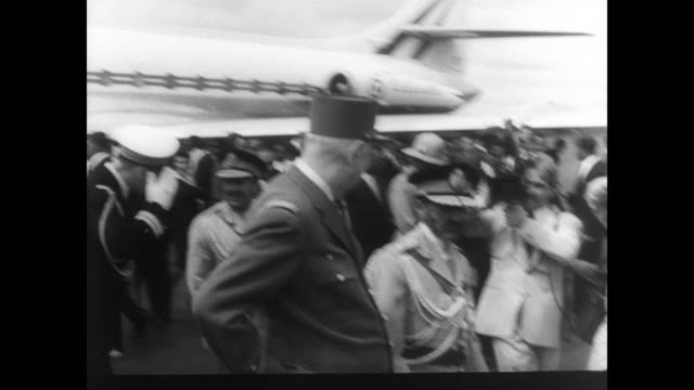 french president charles de gaulle stands in back of car as he greets crowd on streets of ethiopia / de gaulle greeted by emperor haile selassie /... - president stock videos & royalty-free footage