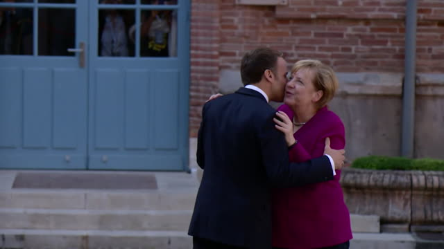 french president emmanuel macron and german chancellor angela merkel meet in toulouse - affectionate stock videos & royalty-free footage