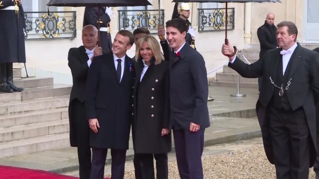 french president emmanuel macron and his wife brigitte macron welcome greek prime minister alexis tsipras, his partner betty batziana, german... - world war ii stock-videos und b-roll-filmmaterial