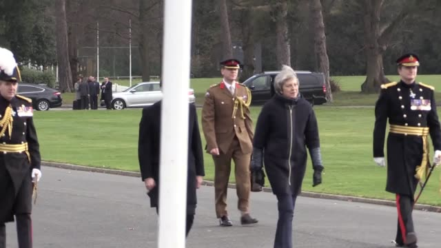 French president Emmanuel Macron and Prime Minister Theresa May arrive at Sandhurst receiving a guard of honour before they hold a plenary meeting