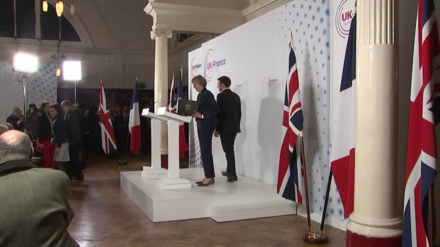 french president emmanuel macron and theresa may taking to the stage, with theresa may speaking in french - french language stock videos & royalty-free footage