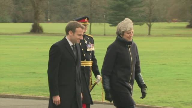 french president emmanuel macron and theresa may walking on to a stage at sandhurst military academy - president of france stock videos & royalty-free footage
