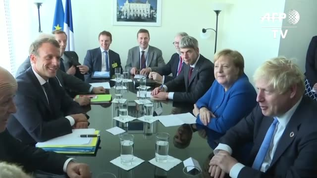 french president emmanuel macron hosts a meeting with german chancellor angela merkel and british prime minister boris johnson on the sidelines of... - angela merkel stock videos & royalty-free footage