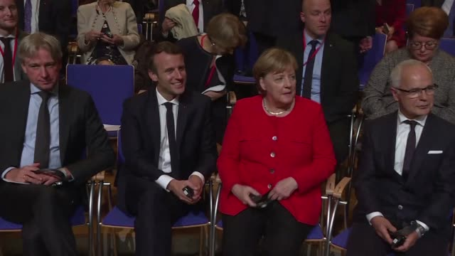 french president emmanuel macron is welcomed by german chancellor angela merkel as they formally open the frankfurt book fair where france is in the... - angela merkel stock videos & royalty-free footage