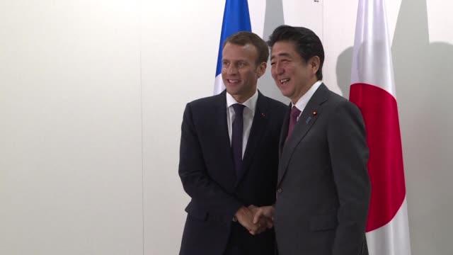 french president emmanuel macron meets japanese prime minister shinzo abe at the st petersburg international economic forum - prime minister video stock e b–roll