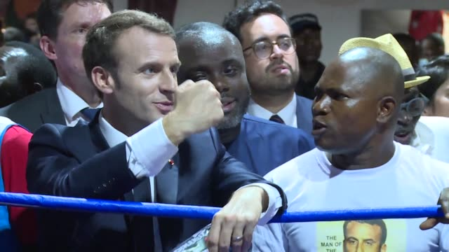 French President Emmanuel Macron meets with Ghanaian youth at a sports complex in Jamestown a popular neighborhood in Accra where he also enjoyed the...