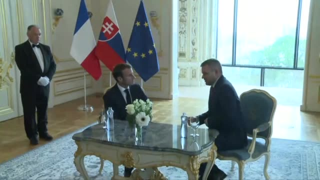 french president emmanuel macron meets with slovakian prime minister peter pellegrini during his official visit to bratislava - prime minister video stock e b–roll