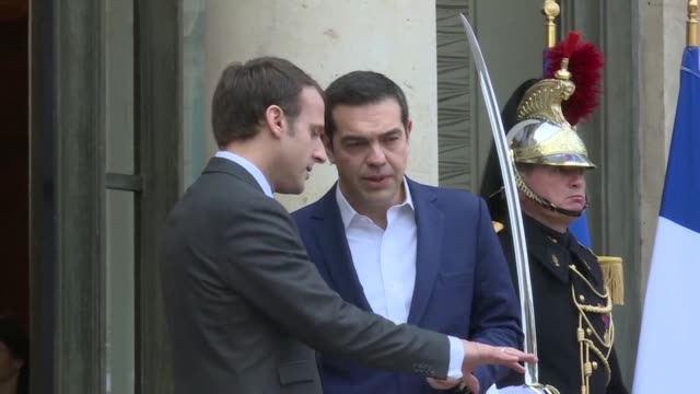 French President Emmanuel Macron on Friday welcomed Greek Prime Minister Alexis Tsipras to the Elysee Palace in Paris