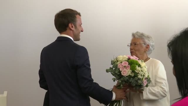 vídeos de stock, filmes e b-roll de french president emmanuel macron presents feminist therese baillif with the insignia of grand officer of the national order of merit for her 50 years... - ilhas mascarene