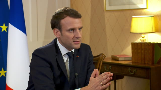 french president emmanuel macron saying he believes the older middle and working class voters felt recent decays were not in their favour in the... - media interview stock videos and b-roll footage