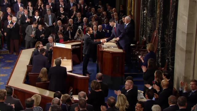 french president emmanuel macron waves to his audience in the house chamber after an address to a joint meeting of congress shaking hands with vice... - united states congress stock videos & royalty-free footage