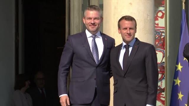french president emmanuel macron welcomes slovakian prime minister peter pellegrini in paris - prime minister video stock e b–roll