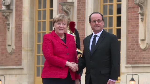 french president francois hollande and german chancellor angela merkel arrive in versailles as the heads of continental europe's biggest economies... - populism stock videos and b-roll footage
